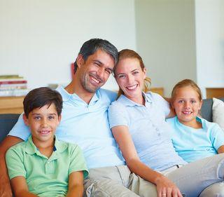 Bigstock_Happy_Family_Sitting_In_The_Li_5283739 (640x562)