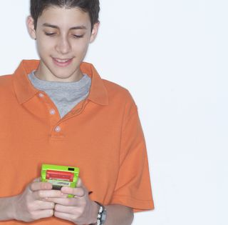 Boy playing hand video game