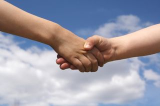 IStock_000000547713XHands in SkySmall