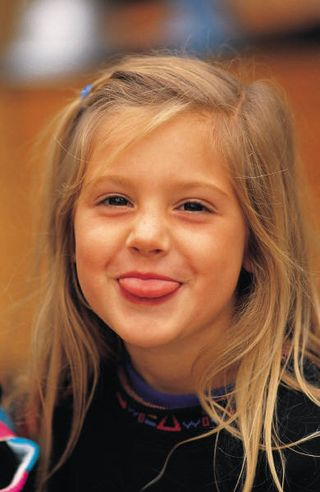 5-year-old sticking tongue out