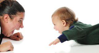 Baby on floor with mom bigstock--6615510