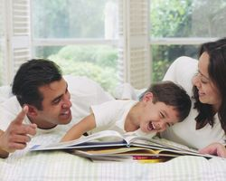 Parents Laughing with Young boy