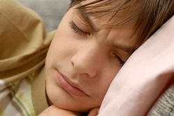 Teenage boy in bed