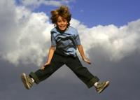 Bigstock_Boy_jumping_triumphantly_in_ai_16234292