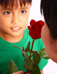 Boy-giving-a-rose-to-his-mother_M1i2nVPd