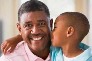 Black child hugging dad