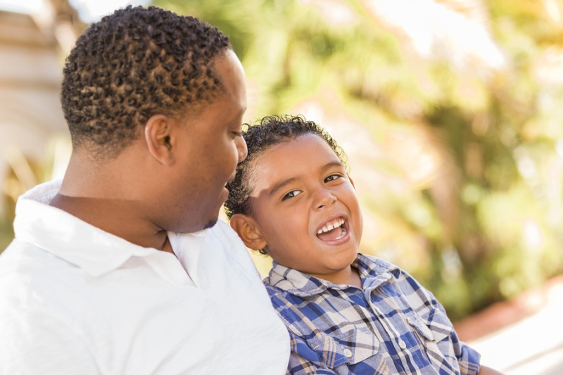 Black Dad Discussing with son